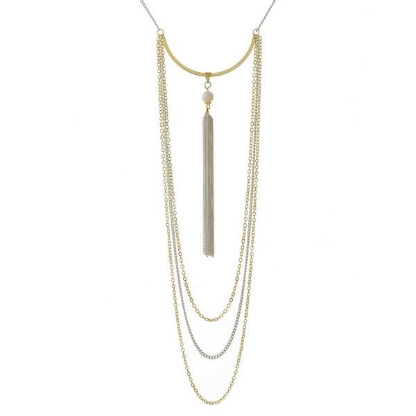 """Gold tone and white necklace featuring a curved bar pendant and chain tassel. Approximately 28"""" in length."""