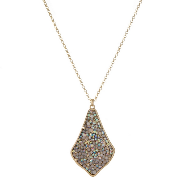 """Gold tone necklace featuring teardrop shaped pendant embellished with opal and iridescent rhinestones. Approximately 32"""" in length."""