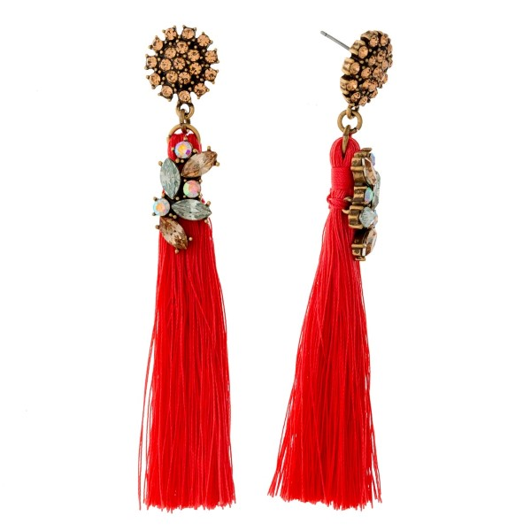 "Gold tone post style earrings with clear rhinestones and a coral tassel. Approximately 3.5"" in length."