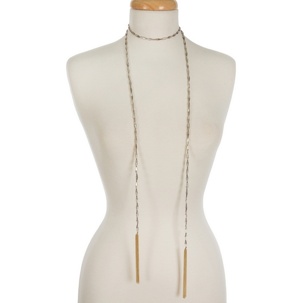"Gray and gold tone beaded wrap necklace featuring chain tassels on the ends. Approximately 60"" in length."