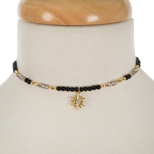 """Gold tone memory wire choker featuring black and gray beads and a star pendant. Approximately 5"""" in diameter. Handmade in the USA."""