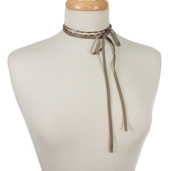 "Gray genuine leather wrap necklace featuring gray beads and gold tone accents. Approximately 60"" in length."