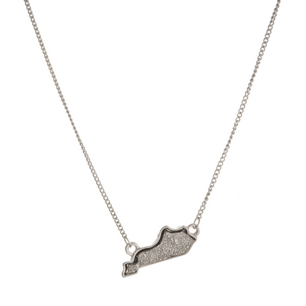 "Dainty silver tone necklace featuring a faux druzy stone pendant in the shape of Kentucky. Approximately 16"" in length."
