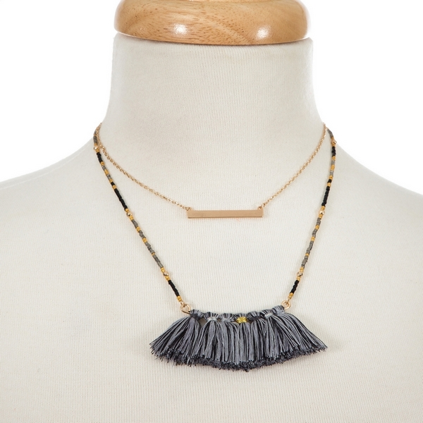 """Gold tone two layer necklace with a gold tone bar pendant and a gray tassel pendant. Approximately 14"""" and 16"""" in length."""