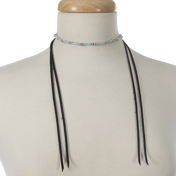 "Silver tone wrap necklace with turquoise beads and black leather wraps. Approximately 40"" in length."