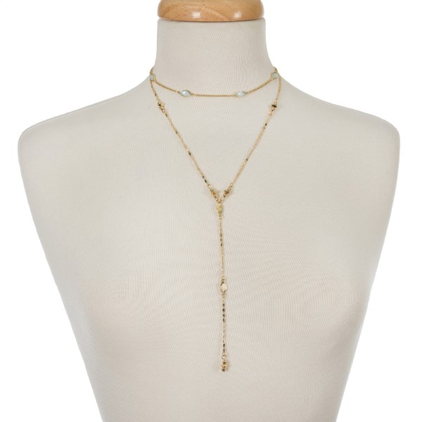 "Gold tone two layer necklace with a choker layer and a 'Y' layer. Approximately 12"" and 18"" in length."