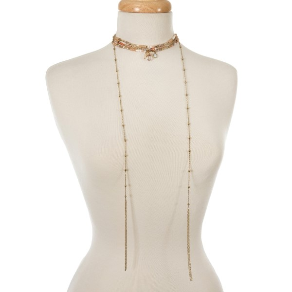 "Peach, champagne, and topaz beaded choker with gold tone chains and tassels. Approximately 12"" in length."