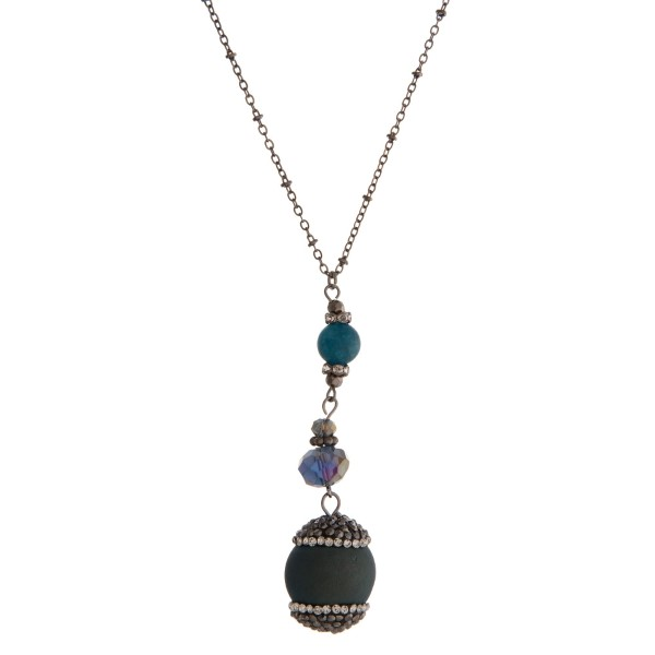 "Hematite necklace with a blue druzy natural stone pendant. Approximately 30"" in length. Each stone is a natural stone and will have some slight deformities."