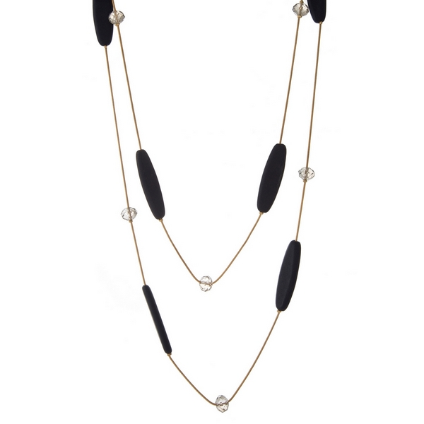 """Gold tone two layer necklace with navy blue wooden beads and clear faceted bead accents. Approximately 24"""" and 32"""" in length."""