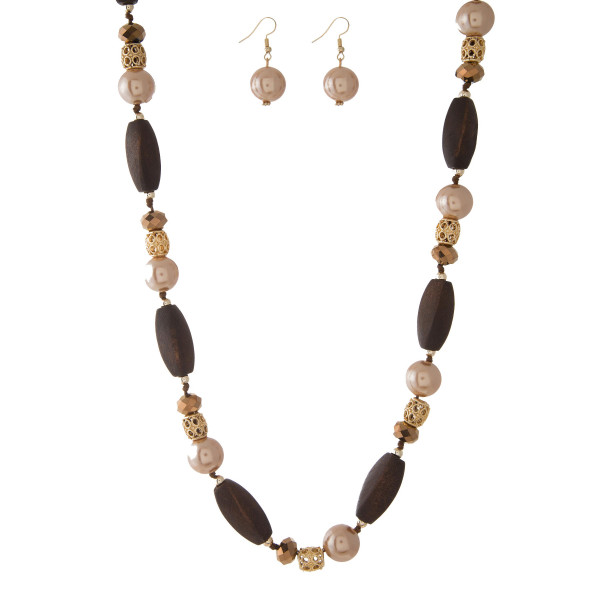 """Brown wooden beaded necklace with champagne pearl beads and matching fishhook earrings. Approximately 40"""" in length."""
