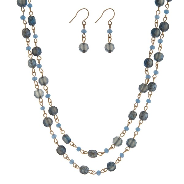 """Gold tone wrap necklace with navy blue beads and matching fishhook earrings. Approximately 60"""" in length."""