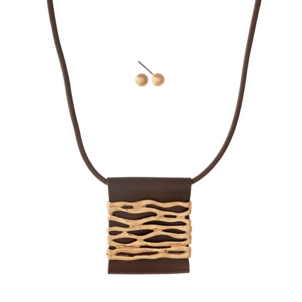 """Brown leather necklace set with a square gold tone, square pendant. Approximately 16"""" in length."""