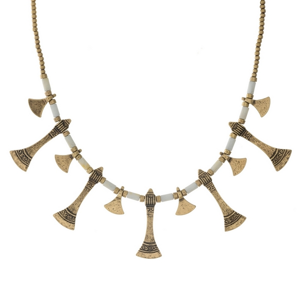 """Gold tone and white beaded necklace with hammered metal fringe. Approximately 16"""" in length."""