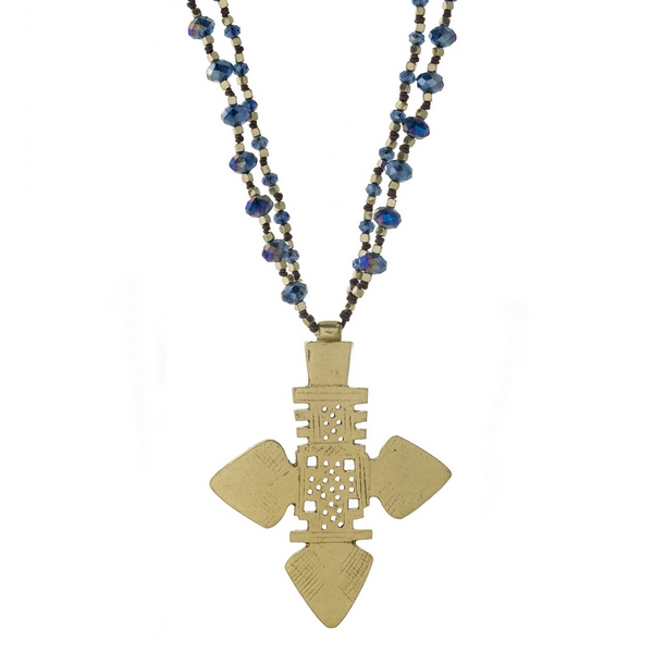 "Gold tone and navy blue beaded statement necklace with a large cross pendant. Approximately 18"" in length. Handmade in the USA."