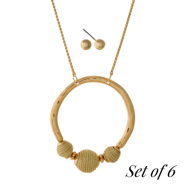 """Set of 6, gold tone necklaces with an open circle pendant with three thread wrapped beads. Adjustable up to 32"""" in length. Set includes the following colors: burgundy, silver/gold, olive green, gold, navy blue, and multi colored."""