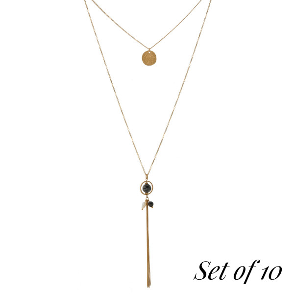 """Set of 10, gold tone necklace with two layers, a natural stone bead and a chain tassel. Approximately 14"""" and 30"""" in length. Set comes with the following natural stones: lapis, gray, picture jasper, beige, carnelian, labradorite, green, tiger's eye, dalmatian jasper, and amazonite."""