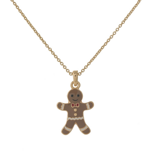 "Dainty gold tone necklace with a gingerbread pendant. Approximately 16"" in length."
