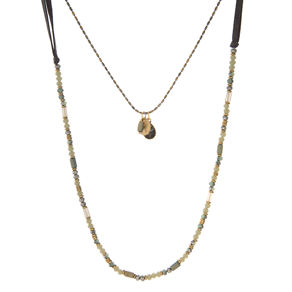 """Gray faux suede, two layer necklace with gray faceted beads and gold tone accents. Approximately 24"""" and 32"""" in length."""