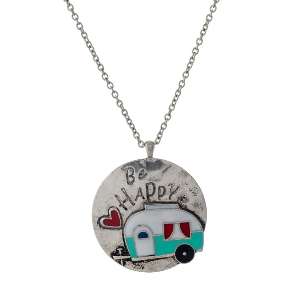 """Silver tone necklace with a circle pendant, stamped with """"Be Happy"""" and a camper accent. Approximately 33"""" in length."""