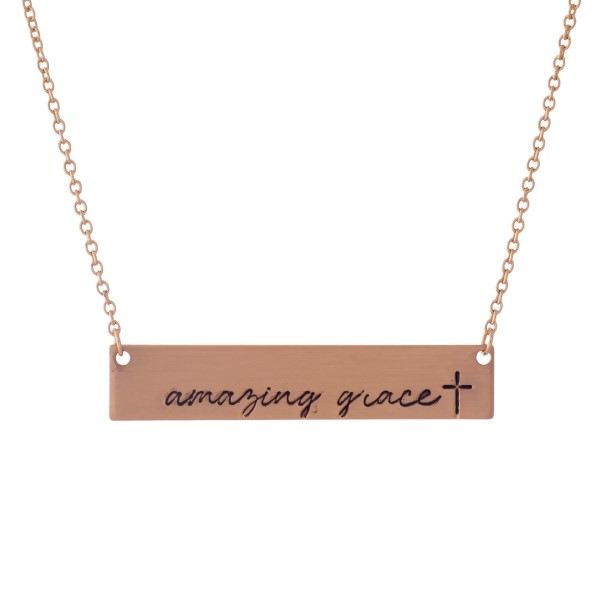 "Dainty rose gold tone necklace with a bar pendant, stamped with ""Amazing Grace."" Approximately 16"" in length."