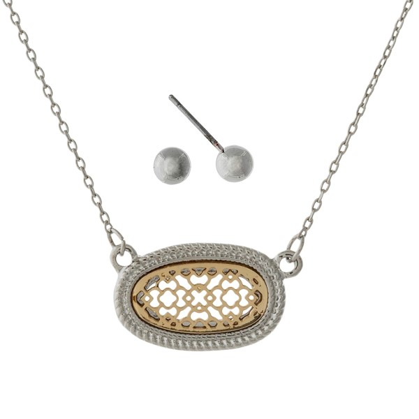"Dainty necklace set with a two tone filigree oval pendant and matching stud earrings. Approximately 16"" in length."