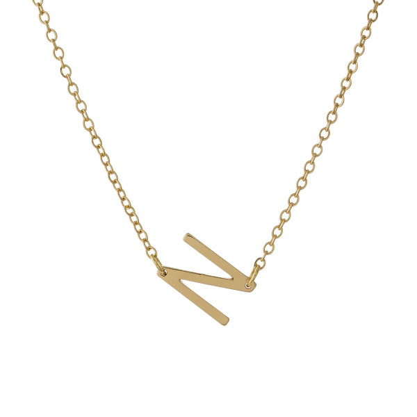 "Dainty gold tone necklace with a sideways initial pendant. Approximately 16"" in length."