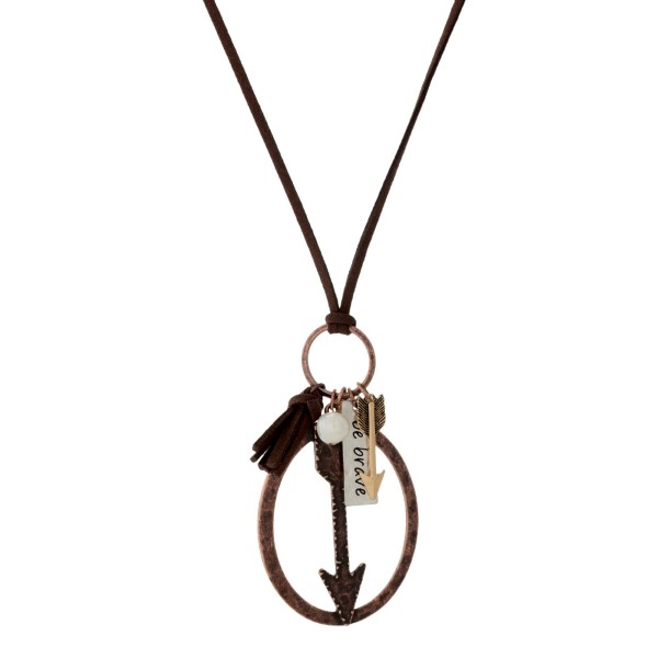 """Faux suede cord necklace with a burnished arrow pendant and freshwater pearl bead accent. Approximately 30"""" in length."""