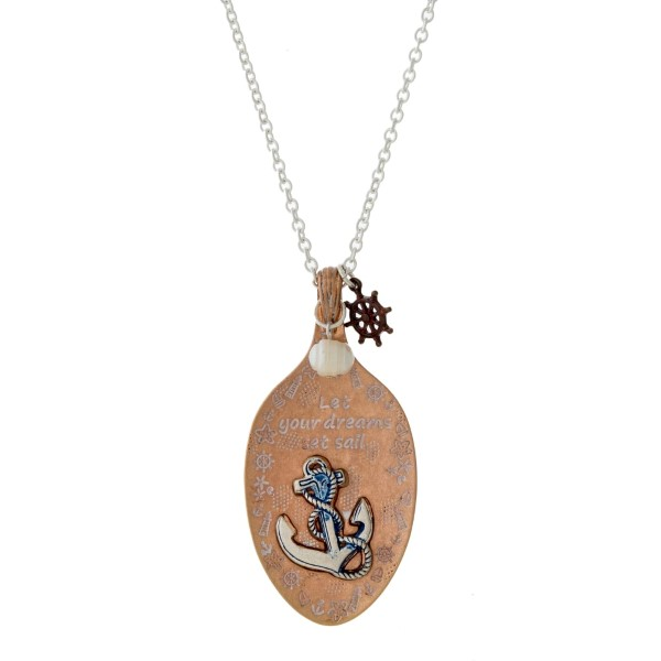 "Long, burnished metal necklace with a spoon pendant and a beach theme. Approximately 30"" in length."