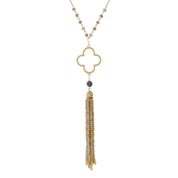 """Gold tone necklace with an open clover shape and an amazonite beaded tassel. Approximately 32"""" in length."""