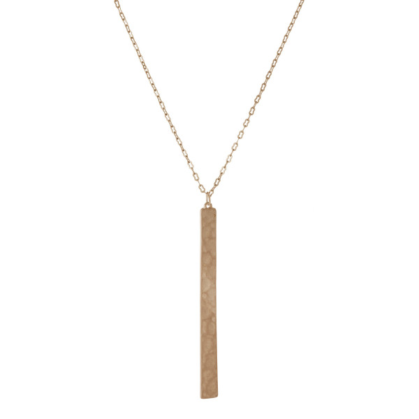 """Long, metal necklace with a hammered bar pendant. Approximately 32"""" in length."""