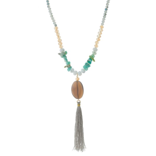 """Full beaded necklace with chip stones, a natural stone pendant and a thread tassel pendant. Approximately 26"""" in length."""