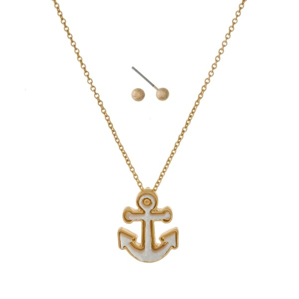 "Dainty, gold tone necklace set with a faux druzy, anchor pendant and matching stud earrings. Approximately 16"" in length."