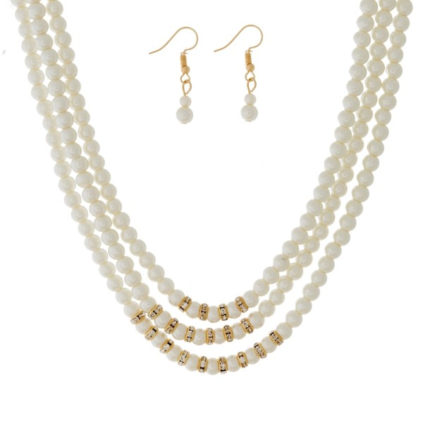 """Three layer, pearl beaded necklace set with gold tone accents and matching fishhook earrings. Approximately 16"""" in length."""