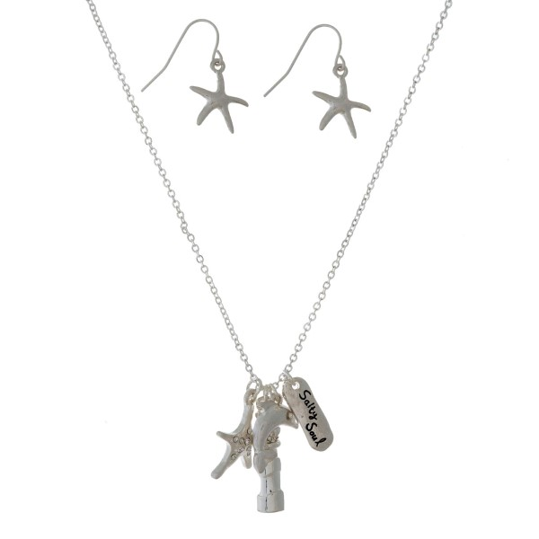 "Dainty, necklace set with a nautical themed charm pendant. Approximately 16"" in length."