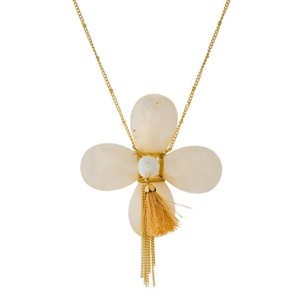 "Gold tone necklace with a mother of pearl flower pendant. Approximately 30"" in length."