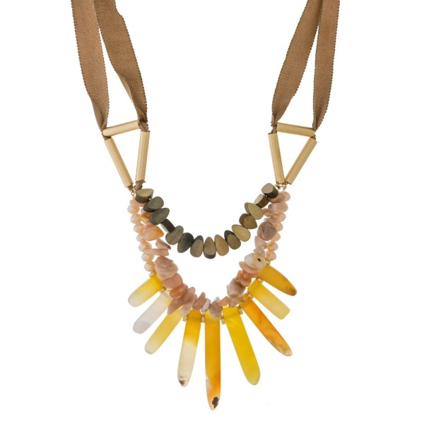 """Statement necklace with a ribbon cord, wooden beads, and natural stones. Approximately 18"""" in length."""