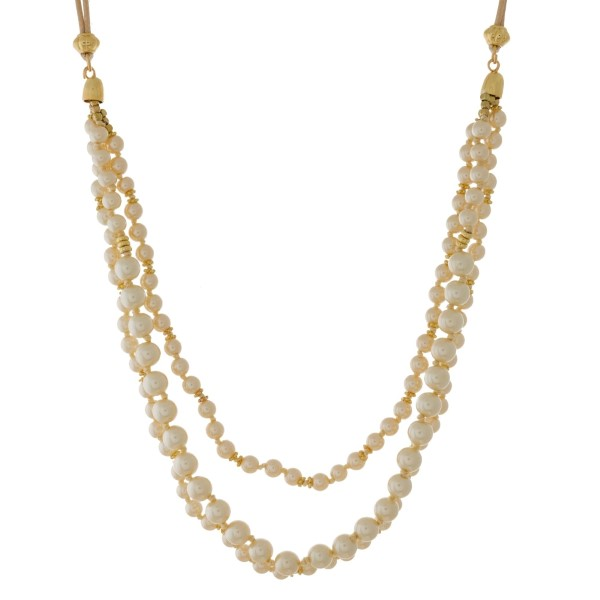 """Tan, waxed cord necklace with layers of pearl beads. Approximately 30"""" in length."""