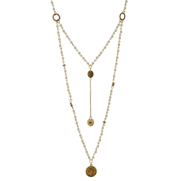 "Gold tone Y necklace with pearl beads and coin pendants. Approximately 20"" and 30"" in length."