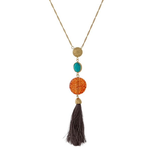 """Gold tone necklace with three natural stone circle pendants and a thread tassel. Approximately 32"""" in length."""