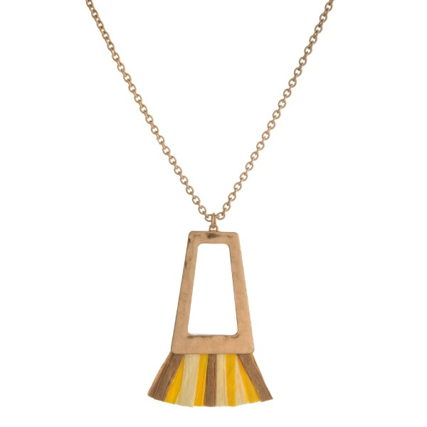 "Gold tone necklace with a hammered, open square shape and ombre raffia tassel. Approximately 32"" in length."