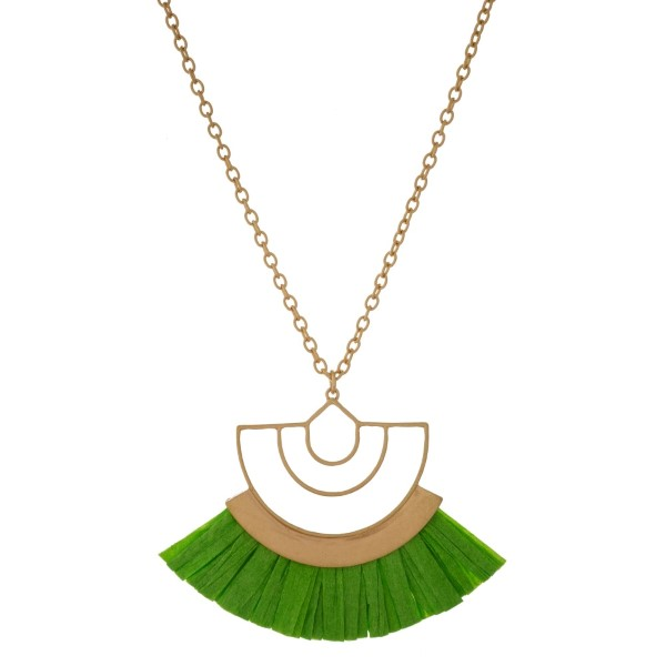 """Gold tone necklace with a geometric pendant and a raffia tassel. Approximately 30"""" in length."""
