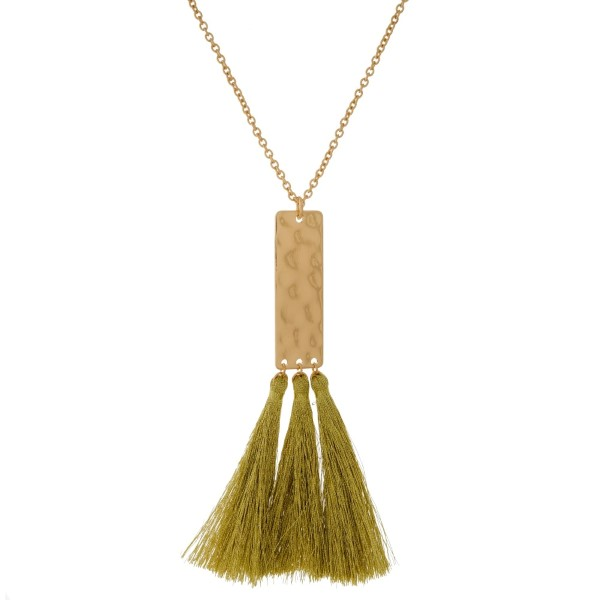 """Long, metal necklace with a hammered rectangle pendant and metallic thread tassels. Approximately 32"""" in length."""