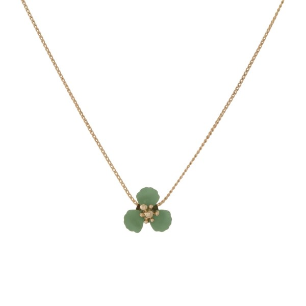 """Dainty, gold tone necklace with a small flower pendant. Adjustable up to 24"""" in length."""