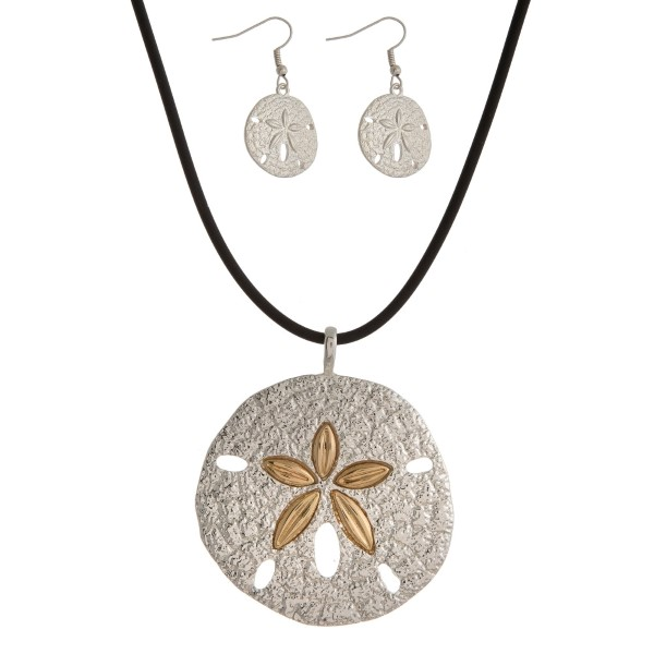 "Black rubber necklace with a two tone sand dollar pendant and matching fishhook earrings. Approximately 16"" in length."
