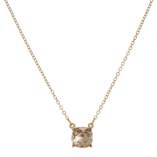 """Dainty gold tone necklace with a square rhinestone pendant. Approximately 16"""" in length."""