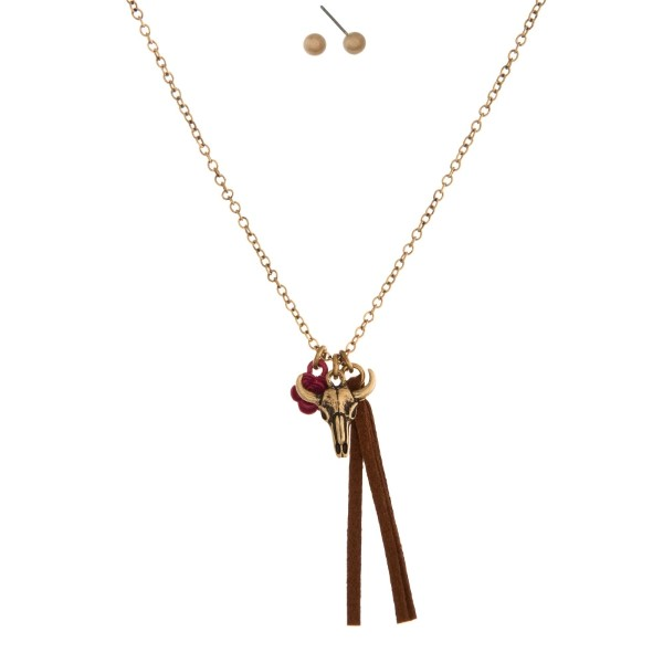"""Dainty necklace set with a steer head skull pendant and matching faux suede tassel. Approximately 16"""" in length."""