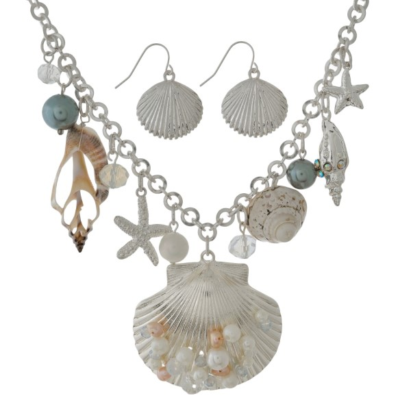 "Silver tone statement necklace set with shell, pearl bead and seashell pendants and matching fishhook earrings. Approximately 16"" in length."