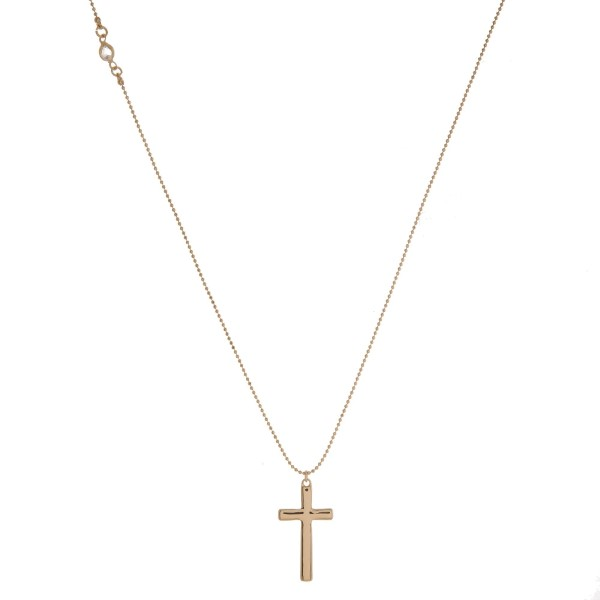 """Dainty metal necklace with a cross pendant. Adjustable up to 24"""" in length."""