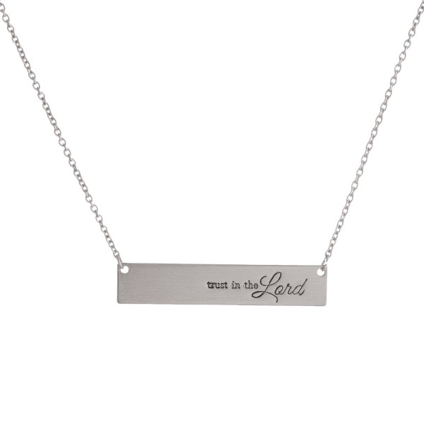 "Dainty metal necklace with a bar pendant stamped with message, ""trust in the Lord."" Approximately 16"" in length."