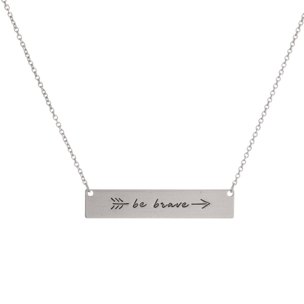 "Dainty metal necklace with a bar pendant stamped with message, ""be brave."" Approximately 16"" in length."
